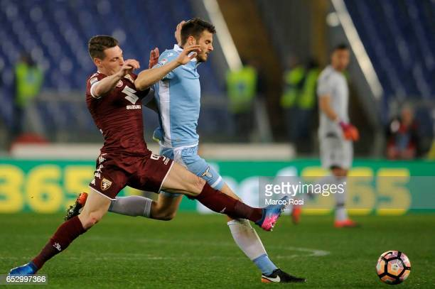 Wesley Hoedt of SS Lazio compete for the ball with Andrea belotti of FC Torino during the Serie A match between SS Lazio and FC Torino at Stadio...