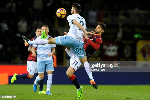 Wesley Hoedt of SS Lazio compete for the ball with Bruno Petkovic of Bologna FC during the Serie A match between Bologna FC and SS Lazio at Stadio...