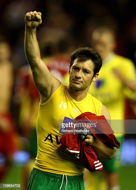 Wesley Hoolahan of Norwich City celebrates in front of the away fans at the end of the Barclays Premier League match between Liverpool and Norwich...