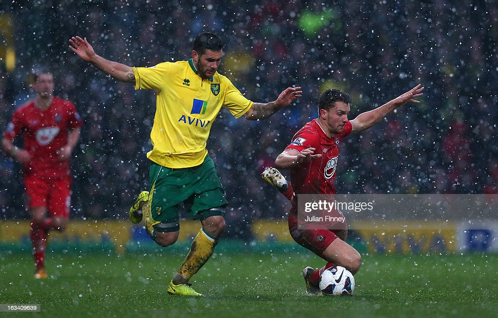 Wesley Hoolahan of Norwich City fouls Jay Rodriguez of Southampton during the Barclays Premier League match between Norwich City and Southampton at Carrow Road on March 9, 2013 in Norwich, England.