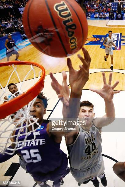 Wesley Iwundu of the Kansas State Wildcats and Konstantinos Mitoglou of the Wake Forest Demon Deacons battle for the ball in the second half during...