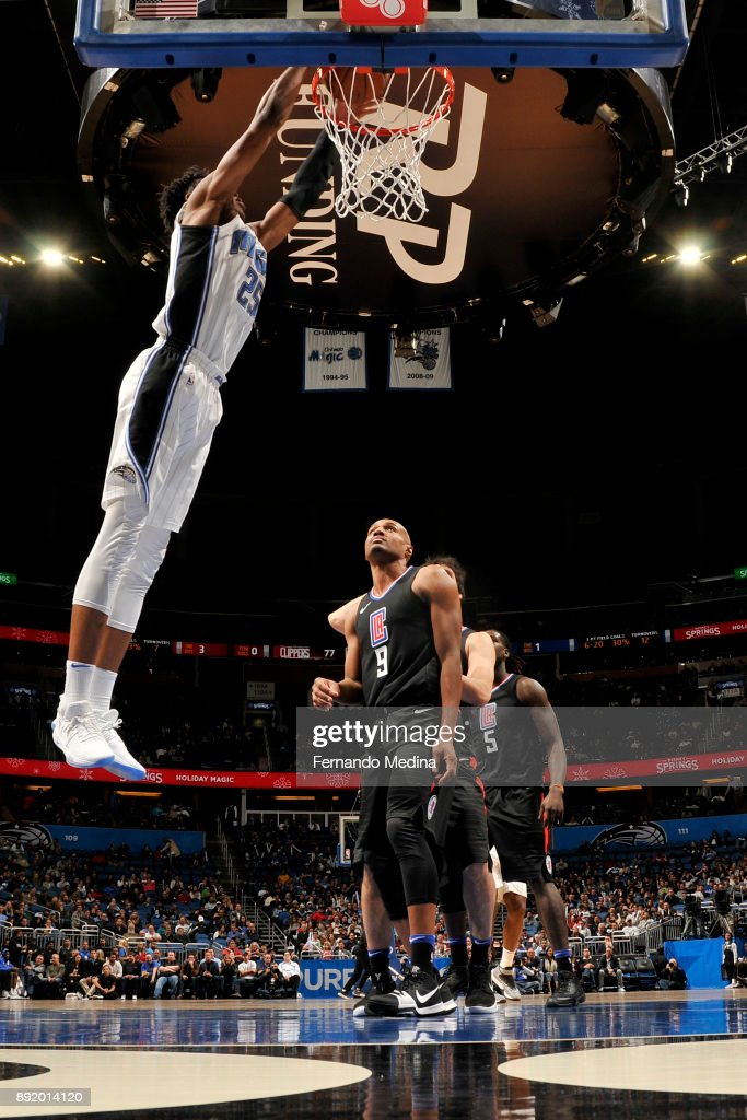 Wesley Iwundu #25 of the Orlando Magic dunks the ball against the LA Clippers on December 13, 2017 at Amway Center in Orlando, Florida.