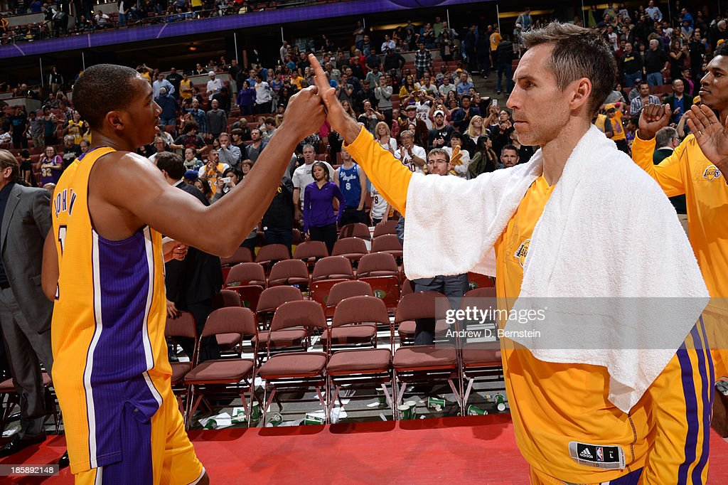 <a gi-track='captionPersonalityLinkClicked' href=/galleries/search?phrase=Wesley+Johnson+-+Basketball+Player&family=editorial&specificpeople=4184049 ng-click='$event.stopPropagation()'>Wesley Johnson</a> #11 and <a gi-track='captionPersonalityLinkClicked' href=/galleries/search?phrase=Steve+Nash+-+Basketball+Player&family=editorial&specificpeople=201513 ng-click='$event.stopPropagation()'>Steve Nash</a> #10 of the Los Angeles Lakers high-five after a preseason game against the Utah Jazz at the Honda Center in Anaheim, California on October 25, 2013.