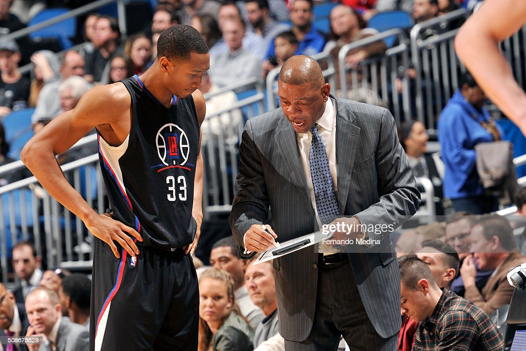 Wesley Johnson #33 of the Los Angeles Clippers discusses the next play with Doc Rivers of the Los Angeles Clippers during the game against the Orlando Magic on February 5, 2016 at Amway Center in Orlando, Florida.