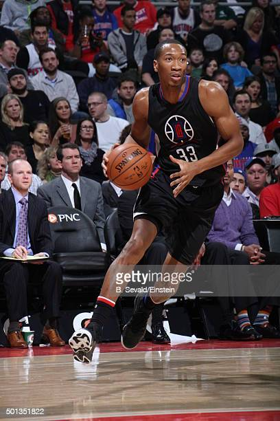 Wesley Johnson of the Los Angeles Clippers dribbles the ball against the Detroit Pistons on December 14 2015 at The Palace of Auburn Hills in Auburn...