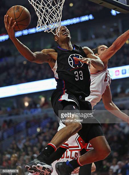 Wesley Johnson of the Los Angeles Clippers goes up for a shot past Joakim Noah of the Chicago Bulls at the United Center on December 10 2015 in...