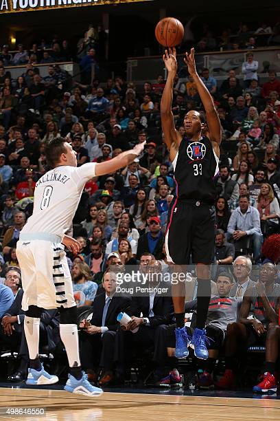 Wesley Johnson of the Los Angeles Clippers takes a shot over Danilo Gallinari of the Denver Nuggets at Pepsi Center on November 24 2015 in Denver...