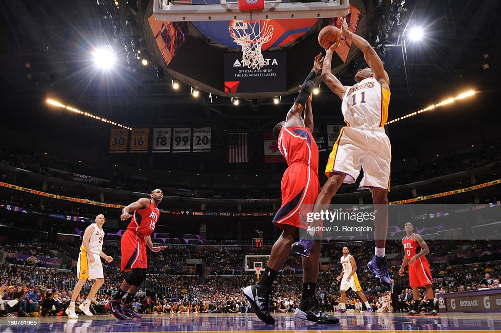 <a gi-track='captionPersonalityLinkClicked' href=/galleries/search?phrase=Wesley+Johnson+-+Basketball+Player&family=editorial&specificpeople=4184049 ng-click='$event.stopPropagation()'>Wesley Johnson</a> #11 of the Los Angeles Lakers attempts a shot against the Atlanta Hawks on November 3, 2013 at STAPLES Center in Los Angeles, California.