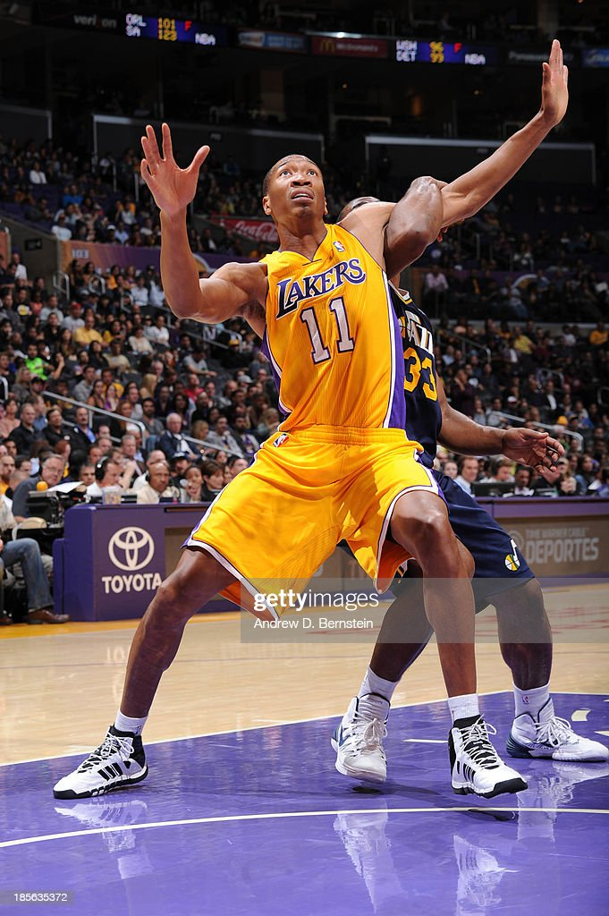 Wesley Johnson #11 of the Los Angeles Lakers boxes out against Mike Harris #33 of the Utah Jazz at Staples Center on October 22, 2013 in Los Angeles, California.