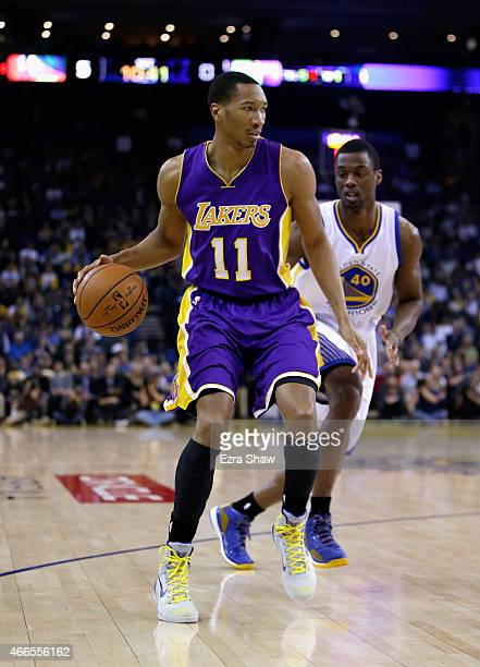 Wesley Johnson of the Los Angeles Lakers dribbles past Harrison Barnes of the Golden State Warriors at ORACLE Arena on March 16 2015 in Oakland...