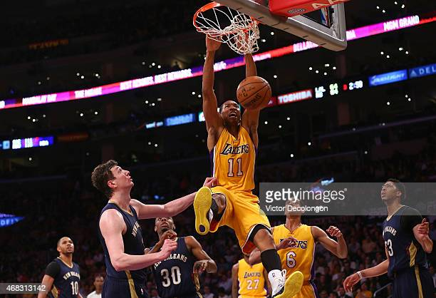 Wesley Johnson of the Los Angeles Lakers follows through on his dunk against the New Orleans Pelicans in the second half during the NBA game at...