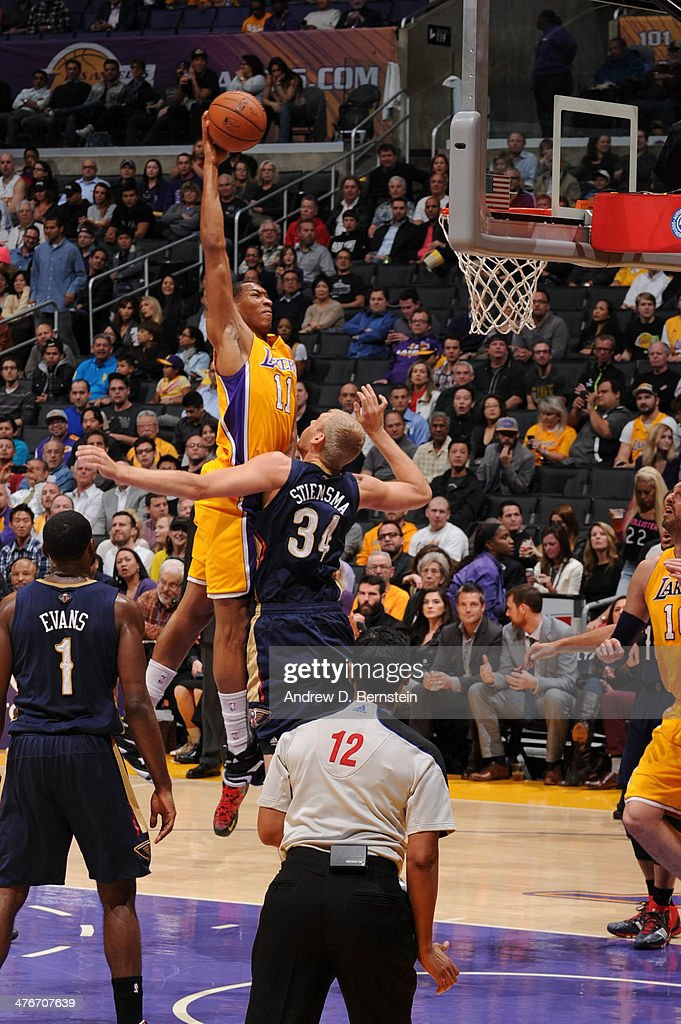Wesley Johnson #11 of the Los Angeles Lakers goes up for a dunk against Greg Stiemsma #34 of the New Orleans Pelicans at Staples Center on March 4, 2014 in Los Angeles, California.