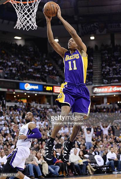 Wesley Johnson of the Los Angeles Lakers goes up to jam the ball against the Sacramento Kings at Sleep Train Arena on December 6 2013 in Sacramento...