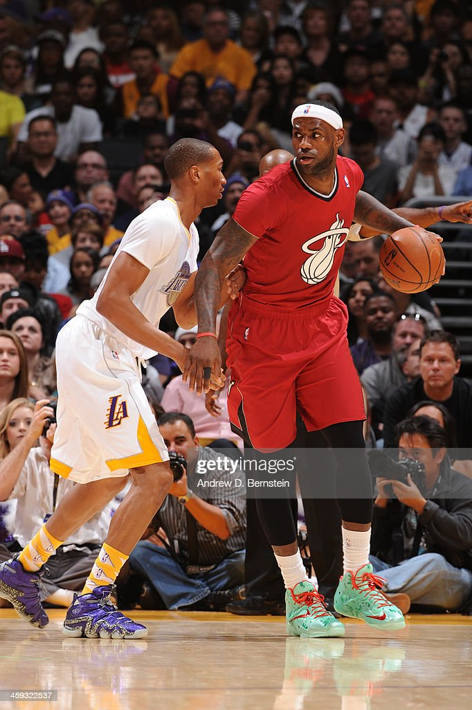 Wesley Johnson of the Los Angeles Lakers guards LeBron James of the Miami Heat at STAPLES Center on December 25 2013 in Los Angeles California NOTE...