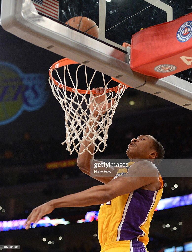 Wesley Johnson #11 of the Los Angeles Lakers misses a dunk during the game against the New Orleans Pelicans at Staples Center on November 12, 2013 in Los Angeles, California.