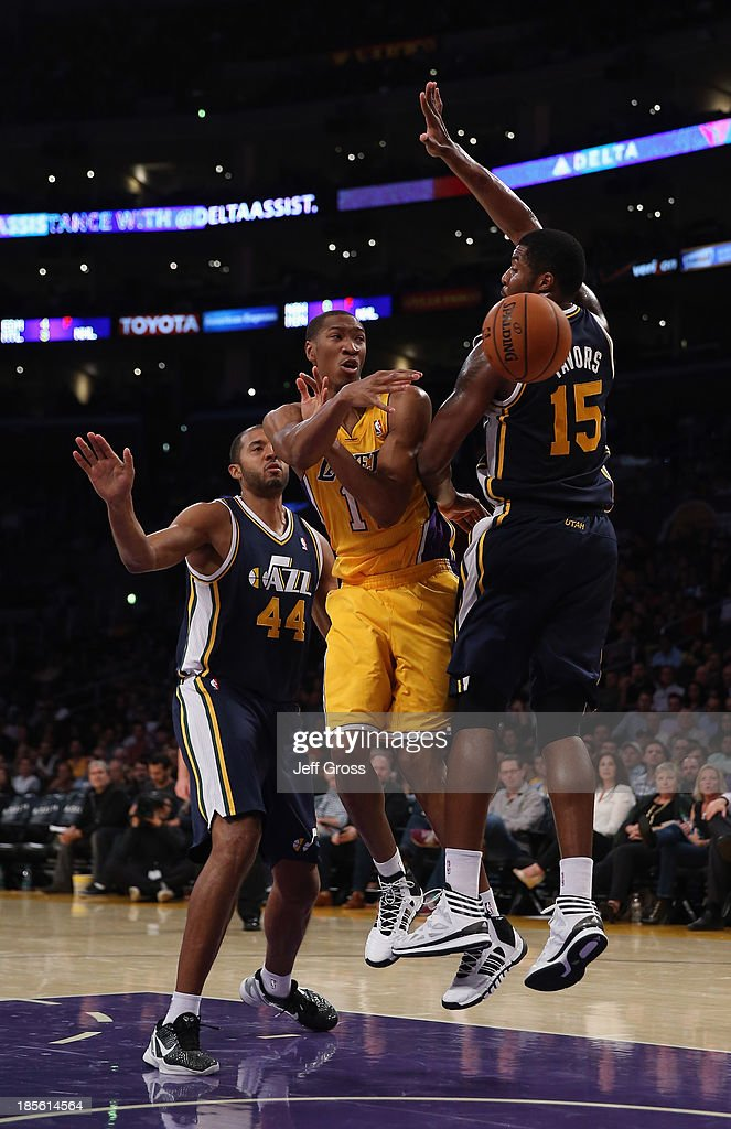 <a gi-track='captionPersonalityLinkClicked' href=/galleries/search?phrase=Wesley+Johnson+-+Basketball+Player&family=editorial&specificpeople=4184049 ng-click='$event.stopPropagation()'>Wesley Johnson</a> #11 of the Los Angeles Lakers passes the ball between <a gi-track='captionPersonalityLinkClicked' href=/galleries/search?phrase=Brian+Cook+-+Basketball+Player&family=editorial&specificpeople=202839 ng-click='$event.stopPropagation()'>Brian Cook</a> (L) #44 and <a gi-track='captionPersonalityLinkClicked' href=/galleries/search?phrase=Derrick+Favors&family=editorial&specificpeople=5792014 ng-click='$event.stopPropagation()'>Derrick Favors</a> #15 of the Utah Jazz in the second half at Staples Center on October 22, 2013 in Los Angeles, California. The Lakers defeated the Jazz 108-94.