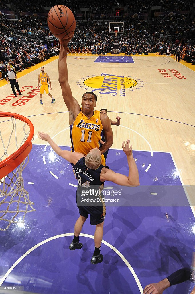 Wesley Johnson #11 of the Los Angeles Lakers rises for a dunk against Greg Stiemsma #34 of the New Orleans Pelicans at Staples Center on March 4, 2014 in Los Angeles, California.