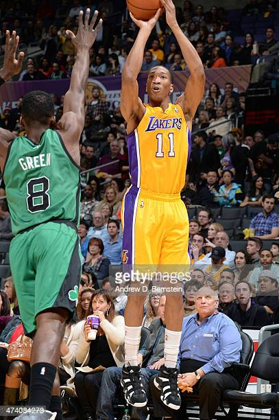 Wesley Johnson of the Los Angeles Lakers shoots against Jeff Green of the Boston Celtics at STAPLES Center on February 21 2014 in Los Angeles...