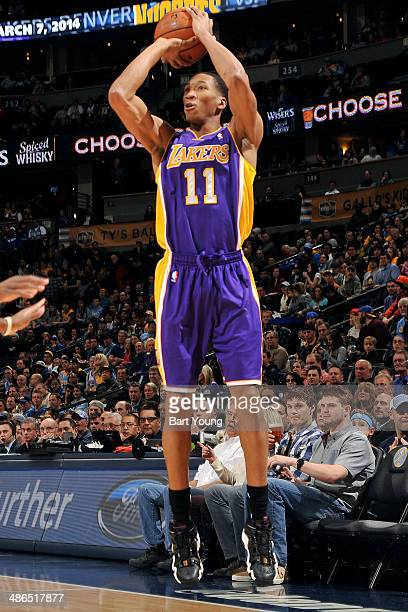 Wesley Johnson of the Los Angeles Lakers shoots against the Denver Nuggets on March 7 2014 at the Pepsi Center in Denver Colorado NOTE TO USER User...