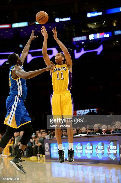 Wesley Johnson of the Los Angeles Lakers shoots against the Golden State Warriors at Staples Center on April 11 2014 in Los Angeles California NOTE...