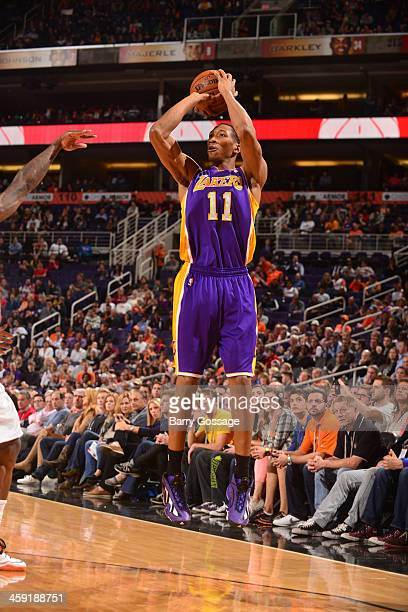 Wesley Johnson of the Los Angeles Lakers shoots against the Phoenix Suns on December 23 2013 at US Airways Center in Phoenix Arizona NOTE TO USER...