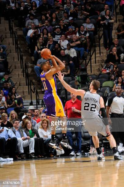 Wesley Johnson of the Los Angeles Lakers shoots against the San Antonio Spurs at the ATT Center on March 14 2014 in San Antonio Texas NOTE TO USER...