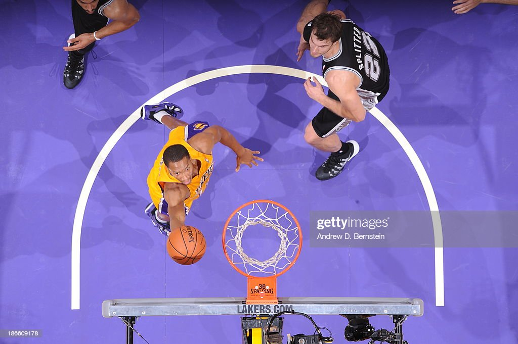 <a gi-track='captionPersonalityLinkClicked' href=/galleries/search?phrase=Wesley+Johnson+-+Basketball+Player&family=editorial&specificpeople=4184049 ng-click='$event.stopPropagation()'>Wesley Johnson</a> #11 of the Los Angeles Lakers shoots against <a gi-track='captionPersonalityLinkClicked' href=/galleries/search?phrase=Tiago+Splitter&family=editorial&specificpeople=208218 ng-click='$event.stopPropagation()'>Tiago Splitter</a> #22 of the San Antonio Spurs on November 1, 2013 at STAPLES Center in Los Angeles, California.