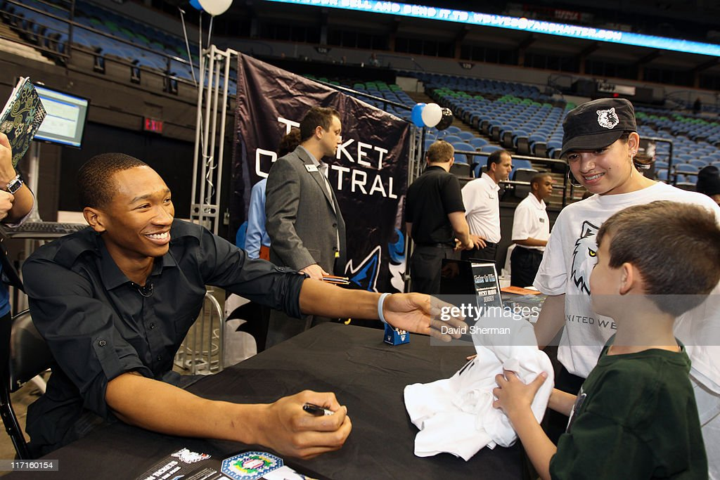 <a gi-track='captionPersonalityLinkClicked' href=/galleries/search?phrase=Wesley+Johnson+-+Basketball+Player&family=editorial&specificpeople=4184049 ng-click='$event.stopPropagation()'>Wesley Johnson</a> of the Minnesota Timberwolves signs autographs at the team's 2011 NBA Draft Party at Target Center on June 23, 2011 in Minneapolis, Minnesota.