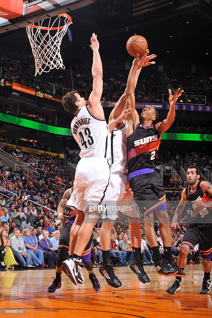 Wesley Johnson #2 of the Phoenix Suns attempts to shoot in the lane against Kris Humphries #43 of the Brooklyn Nets on March 24, 2013 at U.S. Airways Center in Phoenix, Arizona.