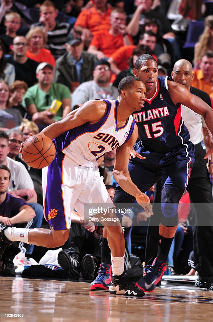 Wesley Johnson #2 of the Phoenix Suns drives against Al Horford #15 of the Atlanta Hawks on March 1, 2013 at U.S. Airways Center in Phoenix, Arizona.
