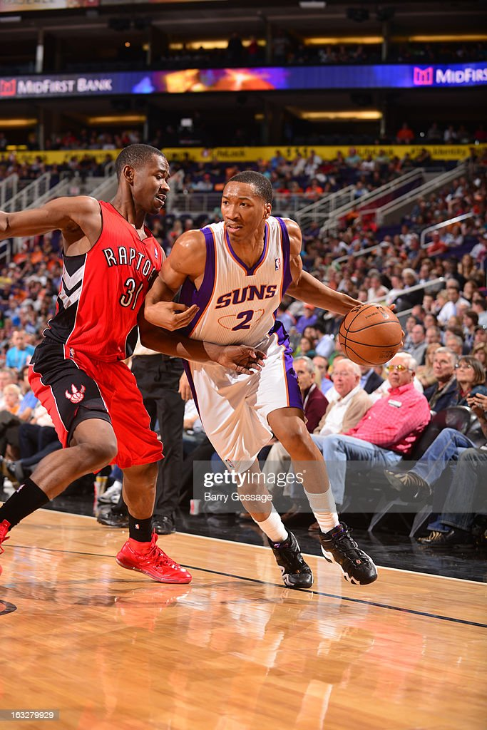 Wesley Johnson #2 of the Phoenix Suns drives against Terrence Ross #31 of the Toronto Raptors on March 6, 2013 at U.S. Airways Center in Phoenix, Arizona.