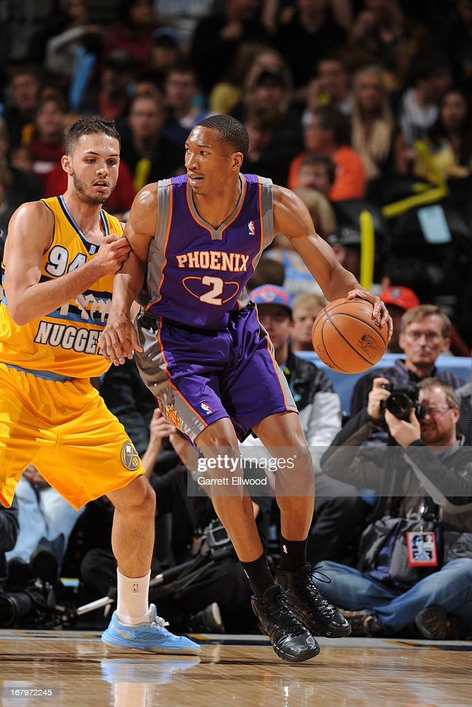 <a gi-track='captionPersonalityLinkClicked' href=/galleries/search?phrase=Wesley+Johnson+-+Basketball+Player&family=editorial&specificpeople=4184049 ng-click='$event.stopPropagation()'>Wesley Johnson</a> #2 of the Phoenix Suns drives to the basket against the Denver Nuggets on April 17, 2013 at the Pepsi Center in Denver, Colorado.