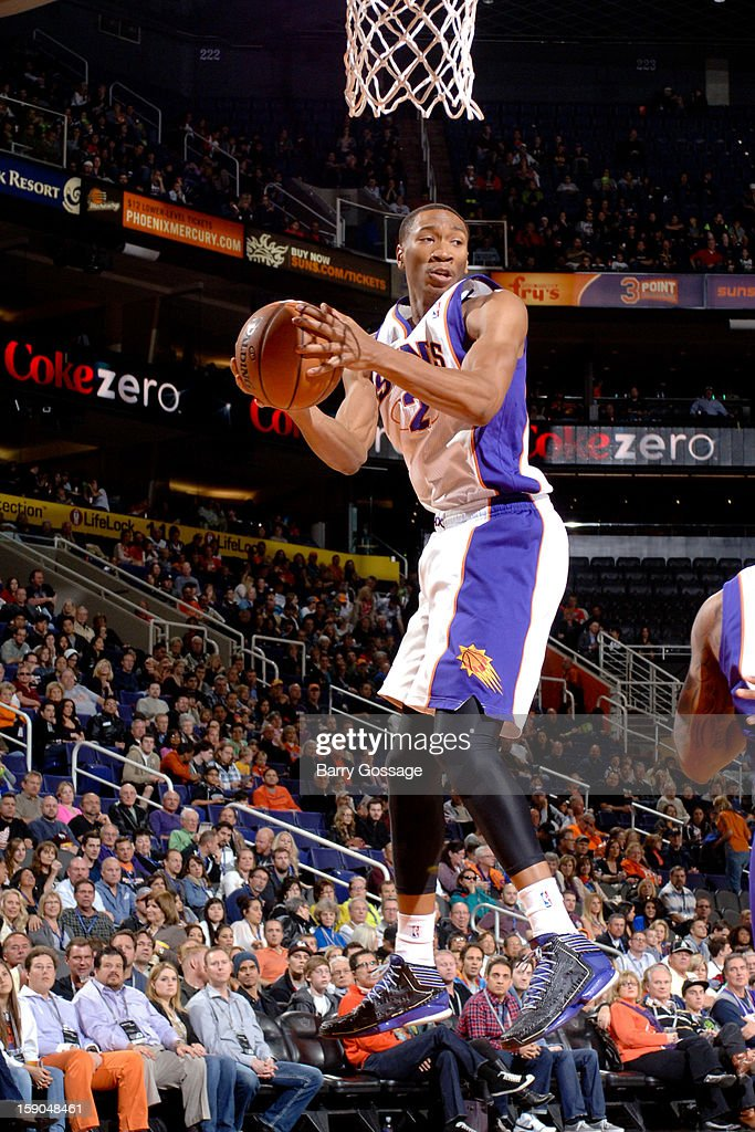 Wesley Johnson #2 of the Phoenix Suns grabs a rebound against the Memphis Grizzlies on January 6, 2013 at U.S. Airways Center in Phoenix, Arizona.