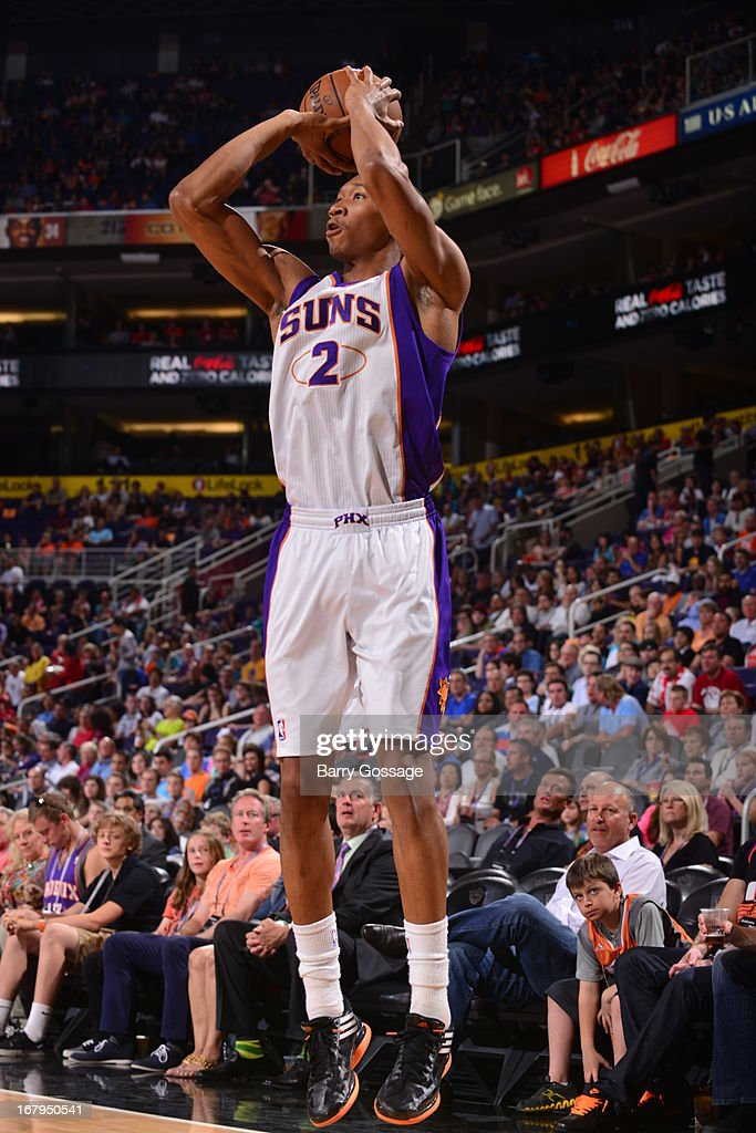 <a gi-track='captionPersonalityLinkClicked' href=/galleries/search?phrase=Wesley+Johnson+-+Basketball+Player&family=editorial&specificpeople=4184049 ng-click='$event.stopPropagation()'>Wesley Johnson</a> #2 of the Phoenix Suns shoots the ball against the Golden State Warriors on April 5, 2013 at U.S. Airways Center in Phoenix, Arizona.