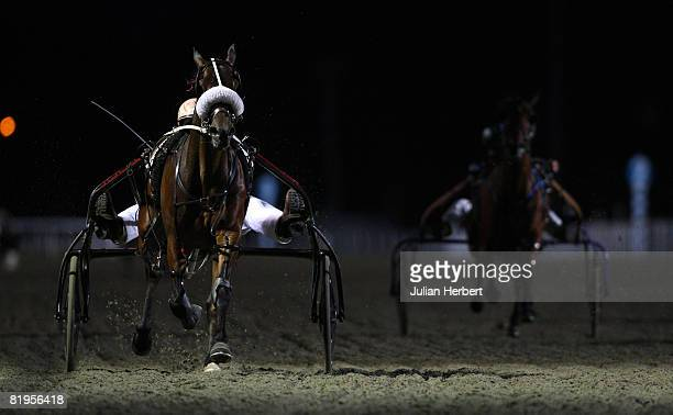 Wesley Jones and Ja Ja Binks win The Harness Racing Trial Race run at Kempton Racecourse July 16 in SunburyonThames England