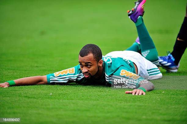 Wesley Lopes Beltrame of Palmeiras falls down during a match between Palmeiras and Santos as part of Paulista Championship 2013 at Pacaembu Stadium...