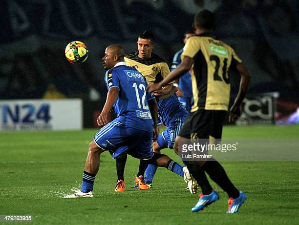 Wesley Lopez of Millonarios fights for the ball with Fabio Rodriguez of Itagüi during a match between Millonarios and Itagüi as part of the Liga...