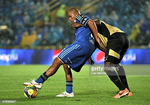 Wesley Lopez of Millonarios fights for the ball with Javier Lopez of Itagüi during a match between Millonarios and Itagüi as part of the Liga...