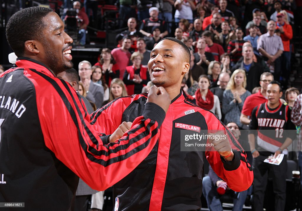 <a gi-track='captionPersonalityLinkClicked' href=/galleries/search?phrase=Wesley+Matthews+-+Basketball+Player&family=editorial&specificpeople=804816 ng-click='$event.stopPropagation()'>Wesley Matthews</a> #2 and <a gi-track='captionPersonalityLinkClicked' href=/galleries/search?phrase=Damian+Lillard&family=editorial&specificpeople=6598327 ng-click='$event.stopPropagation()'>Damian Lillard</a> #0 of the Portland Trail Blazers smile after the game against the New Orleans Pelicans on December 21, 2013 at the Moda Center Arena in Portland, Oregon.