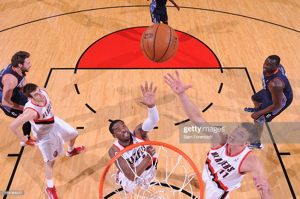 Wesley Matthews #2 and Meyers Leonard #11 of the Portland Trail Blazers go up for a rebound against the Charlotte Bobcats on March 4, 2013 at the Rose Garden Arena in Portland, Oregon.