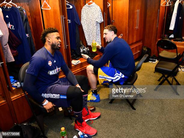Wesley Matthews of the Dallas Mavericks and Play Thompson of the Golden State Warriors talk in the locker room before State Farm AllStar Saturday...