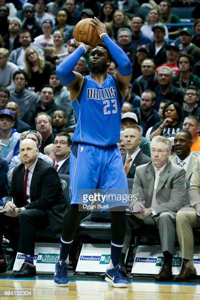 Wesley Matthews of the Dallas Mavericks attempts a shot in the fourth quarter against the Milwaukee Bucks at BMO Harris Bradley Center on April 2...