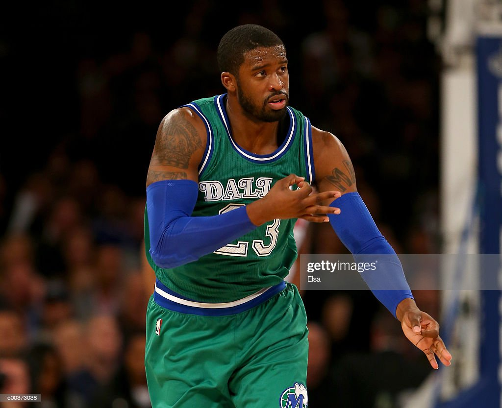 <a gi-track='captionPersonalityLinkClicked' href=/galleries/search?phrase=Wesley+Matthews&family=editorial&specificpeople=804816 ng-click='$event.stopPropagation()'>Wesley Matthews</a> #23 of the Dallas Mavericks celebrates his three point shot in the second half against the New York Knicks at Madison Square Garden on December 7, 2015 in New York City.The Dallas Mavericks defeated the New York Knicks 104-97.