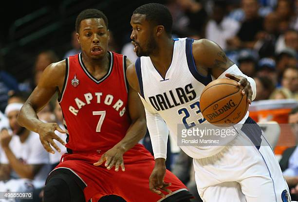 Wesley Matthews of the Dallas Mavericks dribbles the ball against Kyle Lowry of the Toronto Raptors at American Airlines Center on November 3 2015 in...