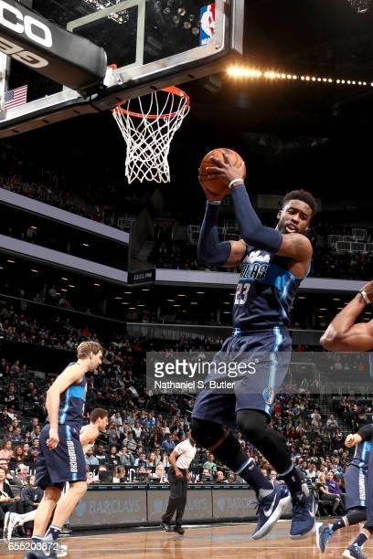 Wesley Matthews of the Dallas Mavericks grabs the rebound against the Brooklyn Nets on March 19 2017 at Barclays Center in Brooklyn New York NOTE TO...