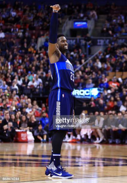 Wesley Matthews of the Dallas Mavericks watches his 3 point attempt during the first half of an NBA game against the Toronto Raptors at Air Canada...