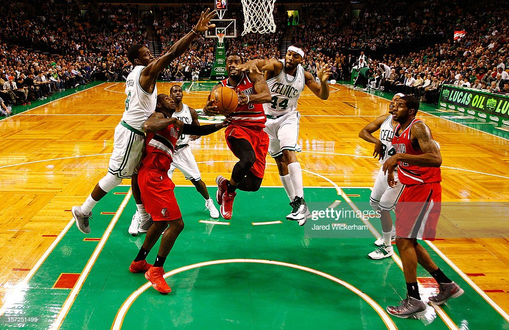 Wesley Matthews #2 of the Portland Trail Blazers attempts to drive to the basket for a layup in front of Chris Wilcox #44 and Jeff Green #8 of the Boston Celtics during the game on November 30, 2012 at TD Garden in Boston, Massachusetts.