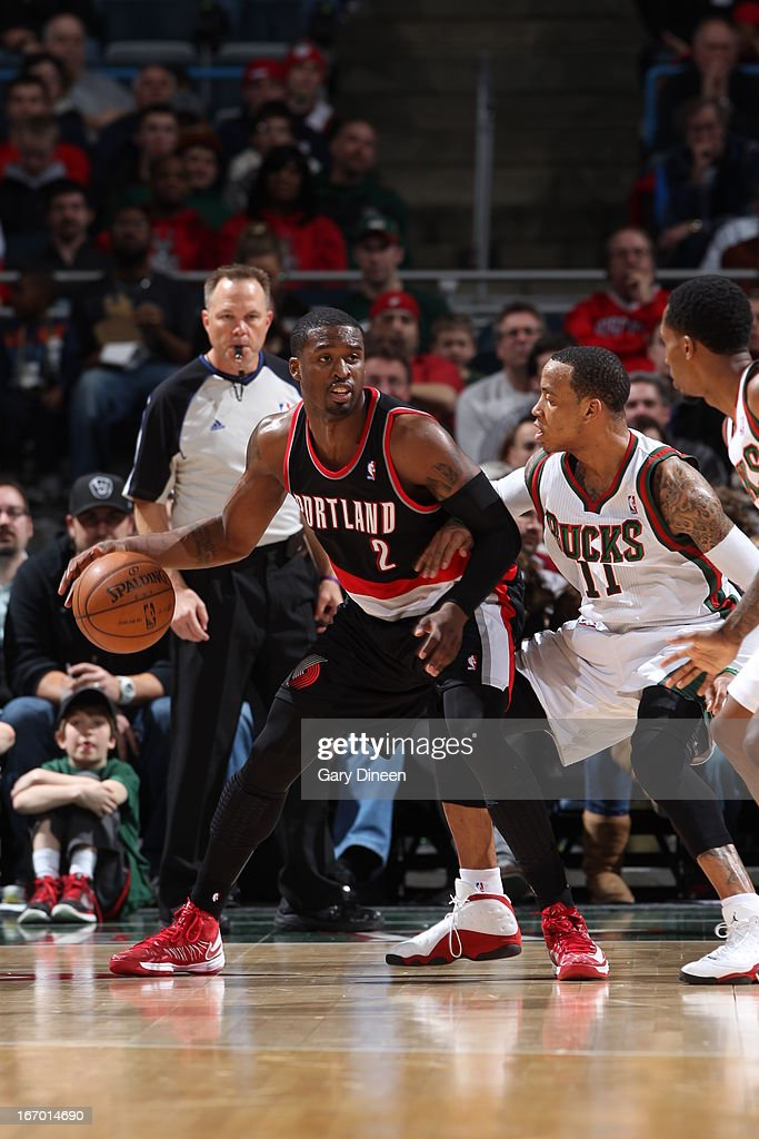 <a gi-track='captionPersonalityLinkClicked' href=/galleries/search?phrase=Wesley+Matthews&family=editorial&specificpeople=804816 ng-click='$event.stopPropagation()'>Wesley Matthews</a> #2 of the Portland Trail Blazers backs up to the basket against <a gi-track='captionPersonalityLinkClicked' href=/galleries/search?phrase=Monta+Ellis&family=editorial&specificpeople=567403 ng-click='$event.stopPropagation()'>Monta Ellis</a> #11 of the Milwaukee Bucks on March 19, 2013 at the BMO Harris Bradley Center in Milwaukee, Wisconsin.
