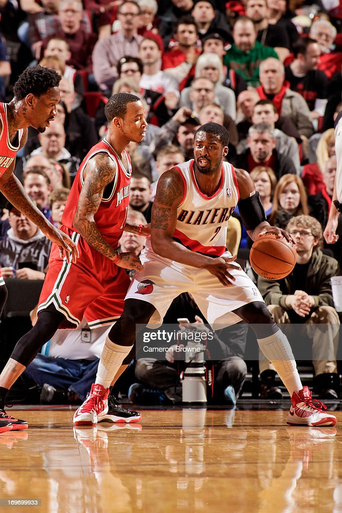 <a gi-track='captionPersonalityLinkClicked' href=/galleries/search?phrase=Wesley+Matthews+-+Basketball+Player&family=editorial&specificpeople=804816 ng-click='$event.stopPropagation()'>Wesley Matthews</a> #2 of the Portland Trail Blazers controls the ball against <a gi-track='captionPersonalityLinkClicked' href=/galleries/search?phrase=Monta+Ellis&family=editorial&specificpeople=567403 ng-click='$event.stopPropagation()'>Monta Ellis</a> #11 of the Milwaukee Bucks on January 19, 2013 at the Rose Garden Arena in Portland, Oregon.