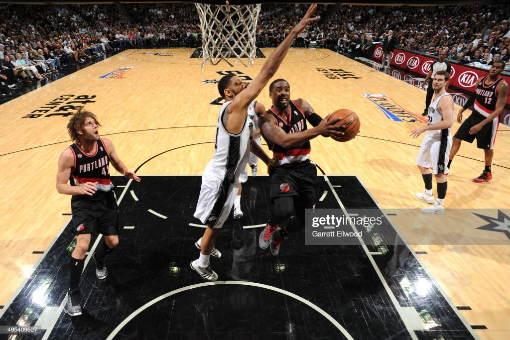 <a gi-track='captionPersonalityLinkClicked' href=/galleries/search?phrase=Wesley+Matthews+-+Basketball+Player&family=editorial&specificpeople=804816 ng-click='$event.stopPropagation()'>Wesley Matthews</a> #2 of the Portland Trail Blazers drives to the basket against <a gi-track='captionPersonalityLinkClicked' href=/galleries/search?phrase=Tim+Duncan&family=editorial&specificpeople=201467 ng-click='$event.stopPropagation()'>Tim Duncan</a> #21 of the San Antonio Spurs in Game One of the Western Conference Semi-Finals during the 2014 NBA Playoffs at AT&T Center on May 6, 2014 in San Antonio, Texas.
